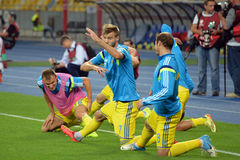 Ukrainian football players warms-up Stock Photography