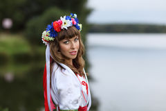 Ukrainian girl on the banks of the river Royalty Free Stock Image
