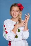 Ukrainian girl on the blue background Royalty Free Stock Photography