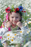 Ukrainian girl on chamomile field Royalty Free Stock Image