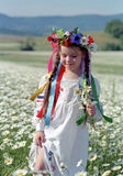 Ukrainian girl on chamomile field Royalty Free Stock Photography