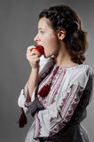 Ukrainian girl eating an apples Stock Photos