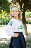 Ukrainian girl with happy face in national costume, floral wreath Stock Photography