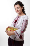 Ukrainian girl holding a bolter with apples Stock Photography