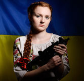 Ukrainian girl with a machine gun Stock Photo