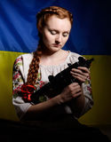 Ukrainian girl with a machine gun Stock Images