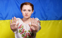 Ukrainian girl at movement of protection Royalty Free Stock Image
