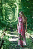 Ukrainian girl in national costume at the natural. Tunnel of love Stock Photography