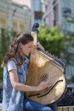 Ukrainian girl playing the harp on the street of Kiev for passersby, Ukraine Stock Images