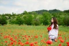 Ukrainian girl in poppy field Royalty Free Stock Photos