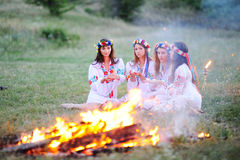 Ukrainian girl in shirts sitting around the campfire Stock Photography