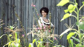 The Ukrainian girl stands on the background of the barn. The Ukrainian girl stands on the background of the barn and posing at the camera. Romantic, sensual stock video