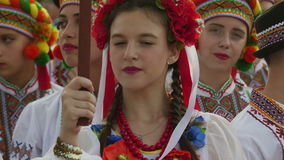 Ukrainian girl in traditional costume at the International Folklore Festival. TULCEA, ROMANIA - AUGUST 08: Ukrainian girl in traditional costume at the stock video footage