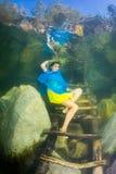 Ukrainian girl under water Stock Photos