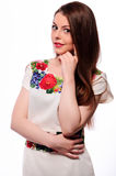 Ukrainian girl wearing national embroidered shirt isolated on white. Portrait of cheerful Ukrainian girl wearing national embroidered shirt isolated on white Stock Photography