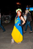 Ukrainian girl wreath. Girl with red hair on a holiday wrapped in the flag of Ukraine Stock Images