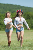 Ukrainian girls in field Royalty Free Stock Image