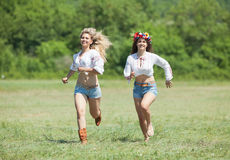 Ukrainian girls in field Royalty Free Stock Photos