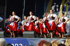 Ukrainian girls in traditional dress dancing a folk dance Stock Images