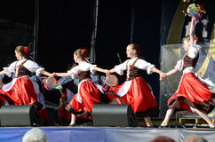 Ukrainian girls in traditional dress dancing a folk dance Stock Image