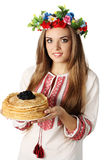 Ukrainian holds pancakes with caviar Royalty Free Stock Photo