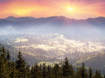 Ukrainian houses in Verkhovyna. Mountain morning of Ukraine in the Carpathians transparent haze in the valleys sunrise gentle and fabulous. Houses of Ukrainian Royalty Free Stock Photos