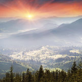 Ukrainian houses in Verkhovyna. Mountain morning of Ukraine in the Carpathians transparent haze in the valleys sunrise gentle and fabulous. Houses of Ukrainian Stock Images