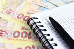 Ukrainian hryvnia. Ukrainian hryvnia to the notebook Royalty Free Stock Images