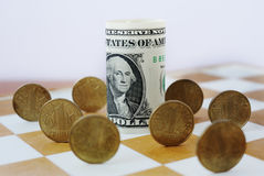 Ukrainian hryvnia on the chessboard. Stock Images