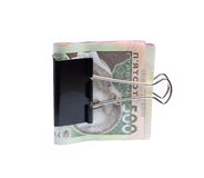 Ukrainian hryvnia clerical clamp. That clamped royalty free stock photos
