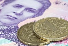 Ukrainian hryvnia coins on the banknote of two hundred hryvnia Royalty Free Stock Photography