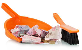 Ukrainian hryvnia in dustpan Stock Photography