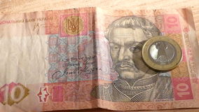 Ukrainian hryvnia and falling euro coins stock video footage