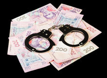 Ukrainian hryvnia with handcuffs close up Royalty Free Stock Photos