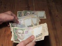 Ukrainian hryvnia. Hands counting banknotes of five hundred ukrainian hryvnia royalty free stock image