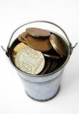 Ukrainian hryvnia iron in the bucket. Royalty Free Stock Photography