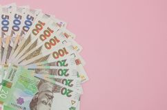 Ukrainian hryvnia on a pink background. Finance crisis in Ukraine, the fall of the hryvnia to the dollar exchange rate.  royalty free stock image