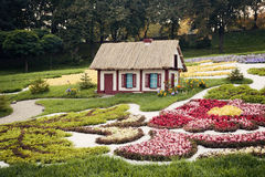 Ukrainian hut flower sculpture landscape – Flower show in Ukraine, 2012. Ukrainian hut landscape made of flowers at the 57th annual flower exhibition in Kiev Royalty Free Stock Photo