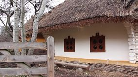 Ukrainian hut with thatched roof stock footage