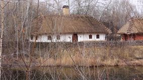 Ukrainian hut with thatched roof stock video footage