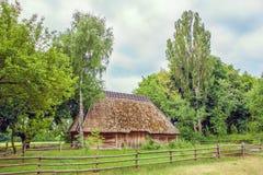 Ukrainian hut thatched sloping field near Stock Image