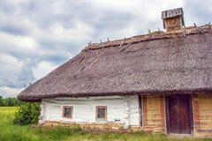 Ukrainian hut thatched sloping field near Stock Photos