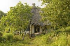 The Ukrainian hut. Water well near Ukrainian hut in the summer Stock Photo