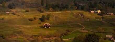 Ukrainian landscape.Autumn warm evening in small Carpathian village West Ukraine. Royalty Free Stock Photo
