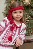 Ukrainian little girl. Portrait of smiling little girl in the Ukrainian national costume at christmas tree Stock Photography