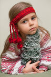 Ukrainian little girl. Portrait of little girl embracing little christmas tree in Ukrainian national costume Stock Photos