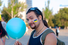 Ukrainian man with balloon. Ukrainian man holding a blue balloon at the festival Royalty Free Stock Photos