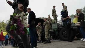 NIKOPOL, UKRAINE - MAY, 9, 2019: Ukrainian military cooks soldiers` porridge and treats people to it at the parade in honor of Vic. Ukrainian military cooks stock video