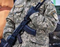Ukrainian military with a gun Stock Photo