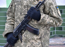 Ukrainian military with a gun_2 Stock Photos